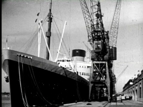 B/W View ship at dock transporting, England / AUDIO