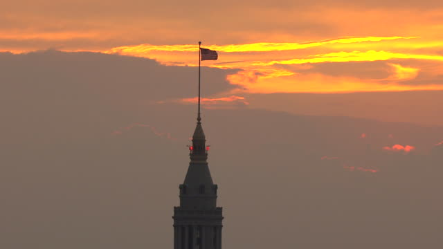 ws ds zi aerial view shot of tower flag during sunset / cleveland, ohio, united states - cleveland stock videos and b-roll footage