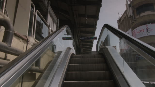 POV view showing an escalator ascent onto the platform of a monorail station in Mumbai India FKAD675A Clip taken from programme rushes ABQA810K