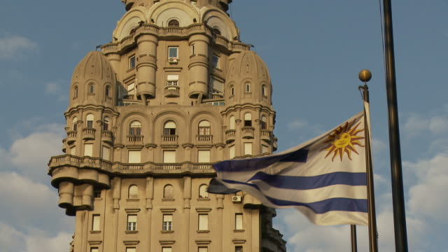 view the flipping flag uruguay - uruguay stock-videos und b-roll-filmmaterial