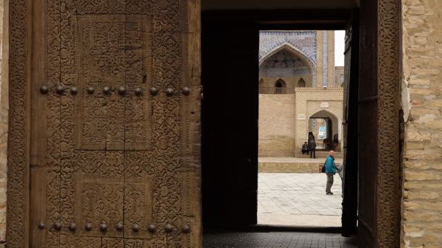 view through a door in a mosaic temple complex - carving craft product stock videos & royalty-free footage