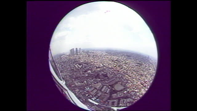 A view through a fish eye lens shows a view of the city of Tokyo.
