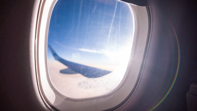 view through airplane window during flight - passenger cabin stock videos & royalty-free footage