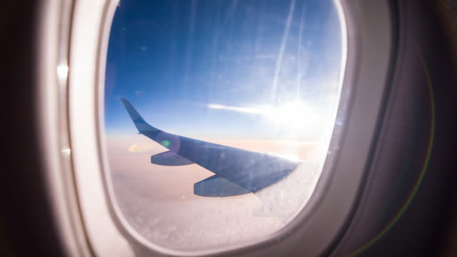 view through airplane window during flight - aircraft wing stock videos & royalty-free footage