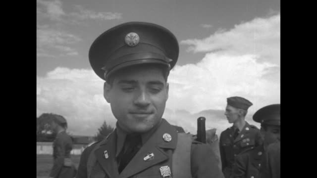 a view through an open flap of tent to men assembling another men and their equipment are delivered to staging area / a young man turns dials on a... - passing a note stock videos & royalty-free footage