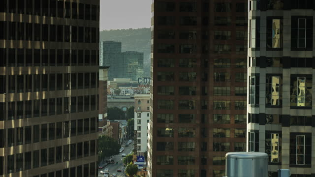 view through downtown office towers - medium shot stock videos & royalty-free footage