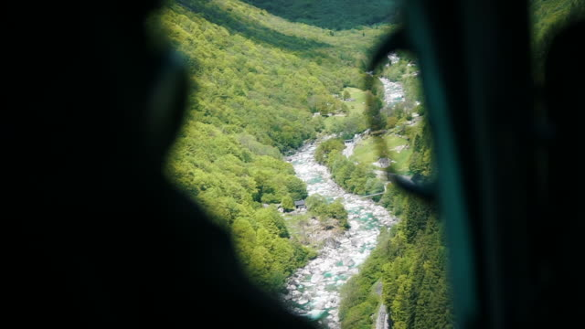 view through helicopter window of alpine river - ticino canton stock videos and b-roll footage