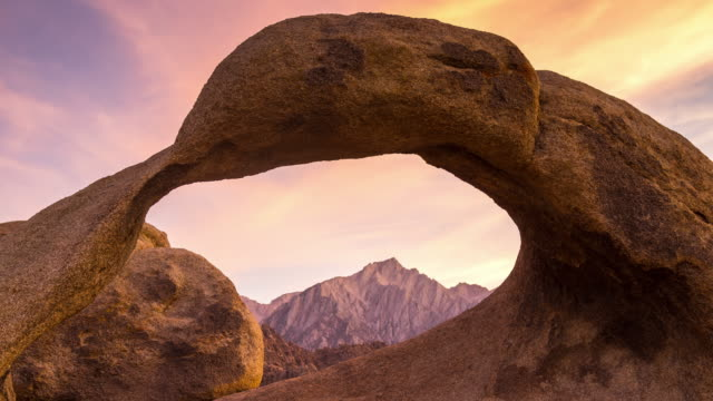 view through natural arch in sierra nevada - time lapse - natural arch stock videos & royalty-free footage