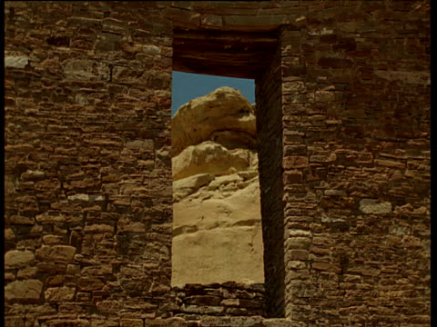 view through opening in ancient anasazi indian ruins, chaco canyon, new mexico - chaco canyon stock videos & royalty-free footage