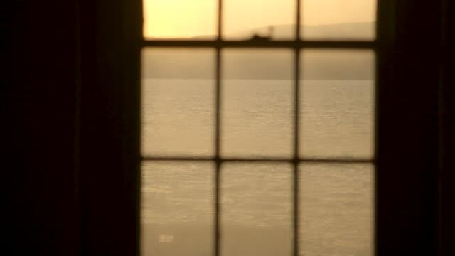 view through sash window to sea - sash window stock videos and b-roll footage