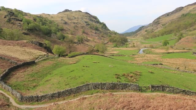 view through the valley leading into watendlath tarn, lake district national park, cumbria, england. - rolling landscape stock videos & royalty-free footage