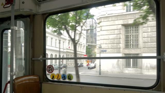 vídeos de stock, filmes e b-roll de view through tram window. - ponto de vista de bonde