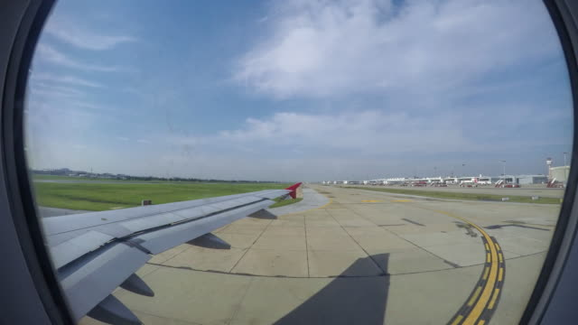 View Through Window Of An Aircraft take off