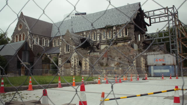 View through wire fence of the earthquake damaged Christchurch Cathedral