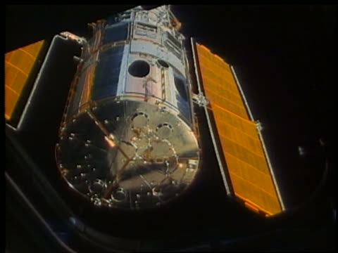view thru window of hubble telescope moving away - sternenteleskop stock-videos und b-roll-filmmaterial