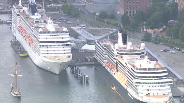 aerial ms view tied cruise at port / kiel canal, schleswig-holstein, germany - schleswig holstein stock-videos und b-roll-filmmaterial