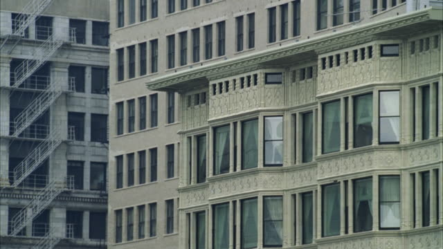 ms view to cluster of older ornate and modern office buildings - fensterfront stock-videos und b-roll-filmmaterial