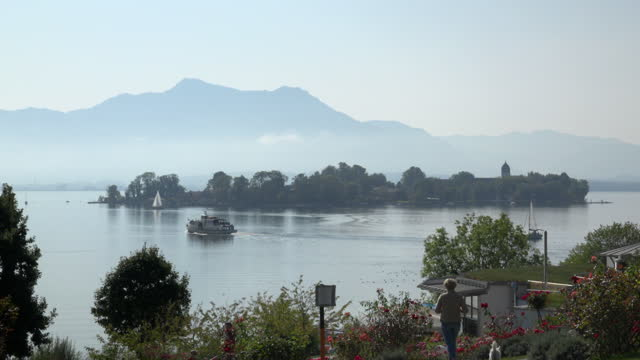 view to fraueninsel on lake chiemsee in front of the bavarian alps - bavarian alps stock videos & royalty-free footage
