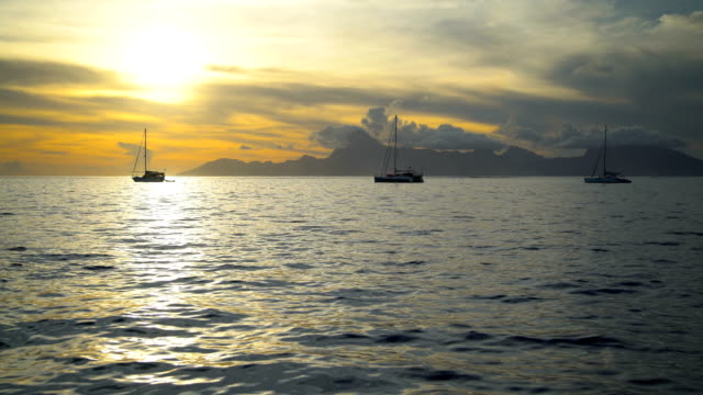 view to moorea from tahiti at sunset pacific - polynesian ethnicity stock videos & royalty-free footage