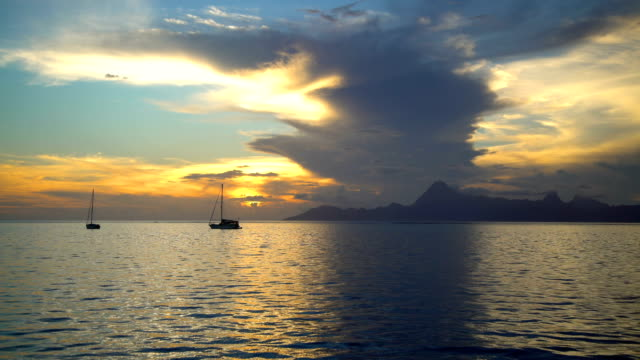 view to moorea from tahiti at sunset pacific - moorea stock videos & royalty-free footage