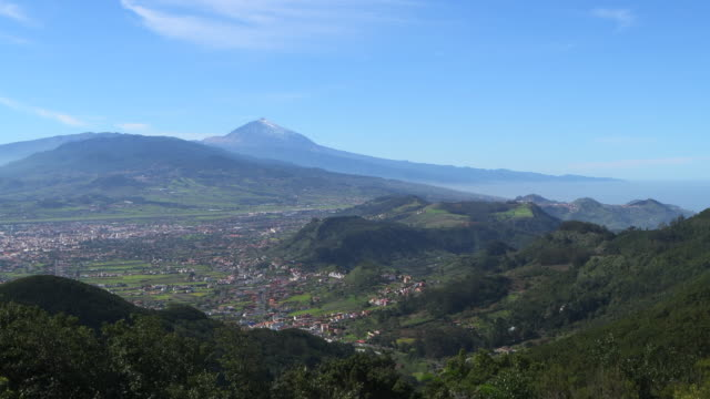 view to the volcano pico del teide (highest mountain of spain) from mirador cruz del carmen in the parque rural de anage. - atlantic islands stock videos & royalty-free footage