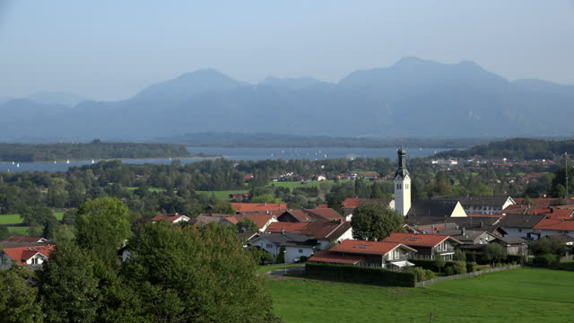 view to village and lake chiemsee - bavarian alps stock videos & royalty-free footage