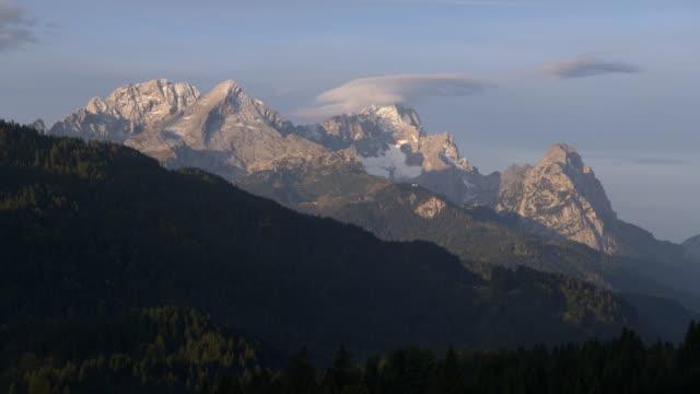 view to zugspitze (highest mountain of germany) near sunrise. zugspitze, garmisch-partenkirchen, werdenfelser land, bavaria, germany. - garmisch partenkirchen stock videos & royalty-free footage