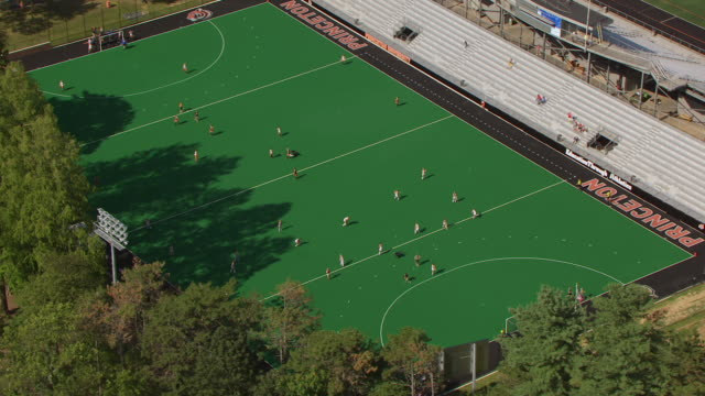 WS AERIAL DS View top over field hockey players on field at Princeton University / Princeton, New Jersey, United States