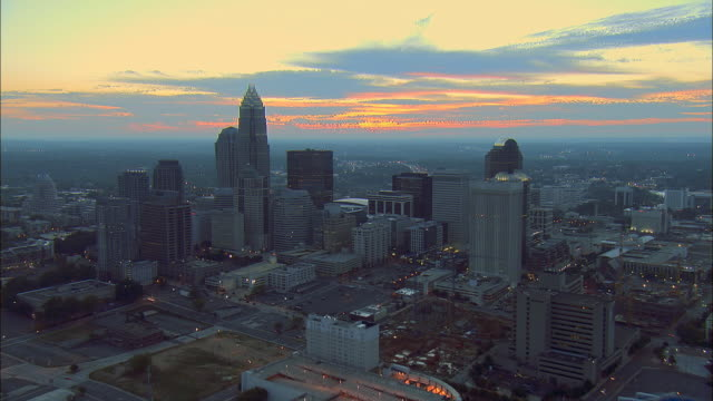 aerial ws view toward bank of america corporate center and downtown cityscape at sunrise / charlotte, north carolina, usa - charlotte north carolina stock videos & royalty-free footage