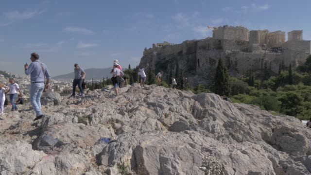 view toward mount lycabettus and visitors near the acropolis, athens, greece, europe - lycabettus hill stock videos & royalty-free footage