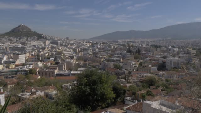view towards mount lycabettus from old town plaka district, athens, greece, europe - lycabettus hill stock videos & royalty-free footage