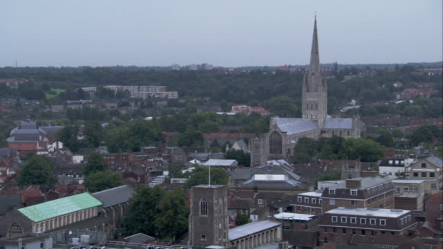 view towards norwich cathedral across the city. available in hd. - norwich england bildbanksvideor och videomaterial från bakom kulisserna