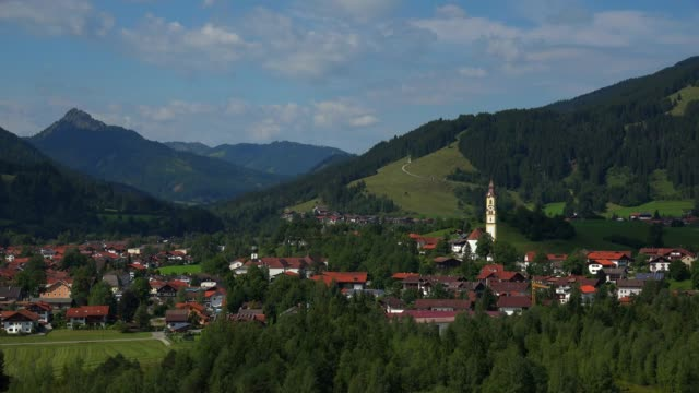 View towards the Town of Pfronten, Allgaeu, Swabia, Bavaria, Germany