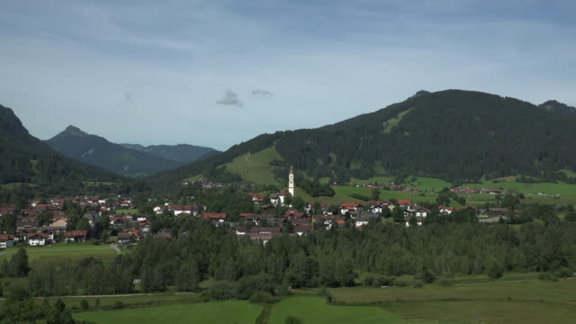 view towards the town of pfronten in the allgaeu, swabia, bavaria, germany - pfronten stock videos and b-roll footage