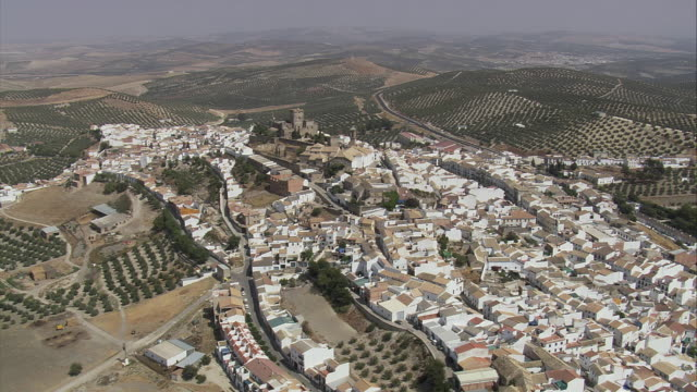ws pov aerial view town and olive groves / espejo, andalusia, spain - espejo stock videos and b-roll footage
