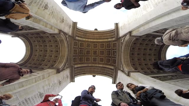 vidéos et rushes de view under the arc de triomphe in paris with wide angle lens recorder from the ground to catch all the construction with the tourists visiting the... - vue en contre plongée