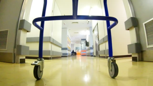 view underneath a medical bed being wheeled down a hospital corridor - rolling stock videos & royalty-free footage