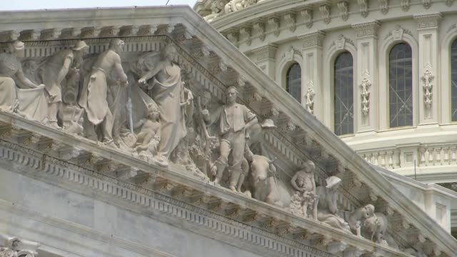 view up from the base of east front steps of the us capitol building to the apotheosis of democracy pediment above second floor entrance to the... - pediment stock videos & royalty-free footage