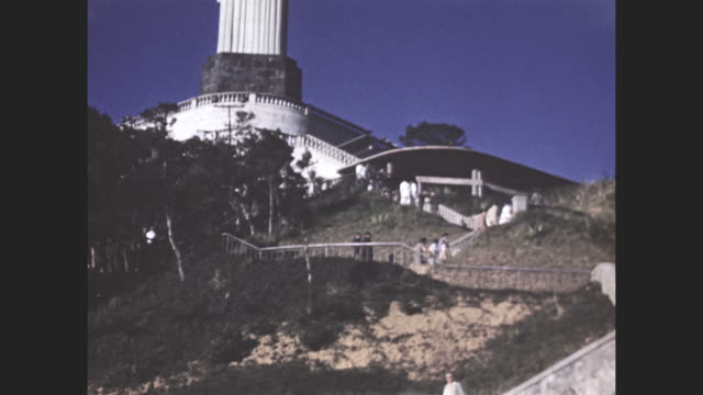 vídeos de stock, filmes e b-roll de view up the stairs toward the christ the redeemer statue.  - 1940