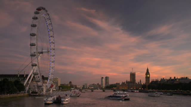 ws view west along river thames with london eye and parliament/uk - millennium wheel stock videos and b-roll footage