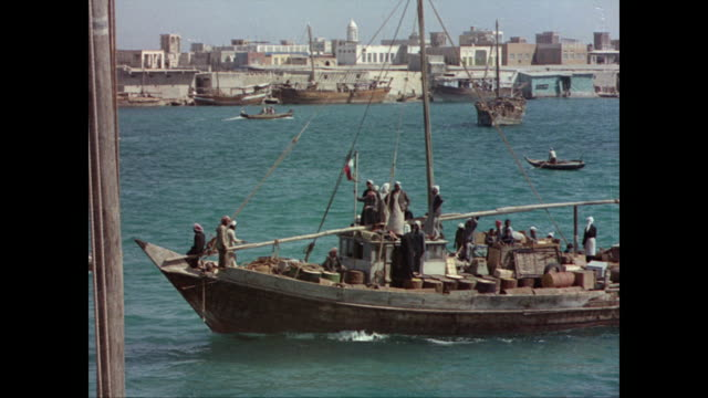 viewed from dubai creek / dubai harbor busy with boats and ships - 1965 stock videos & royalty-free footage