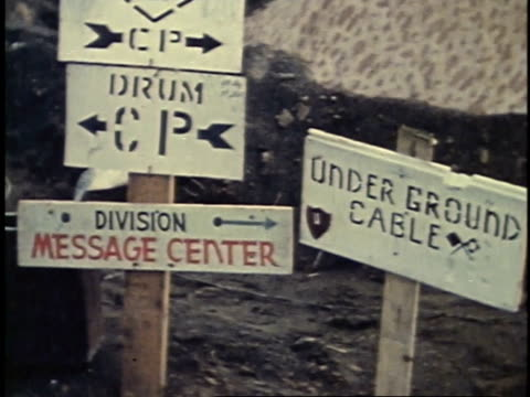 viewing posted signs at camp / iwo jima - battle of iwo jima stock videos and b-roll footage