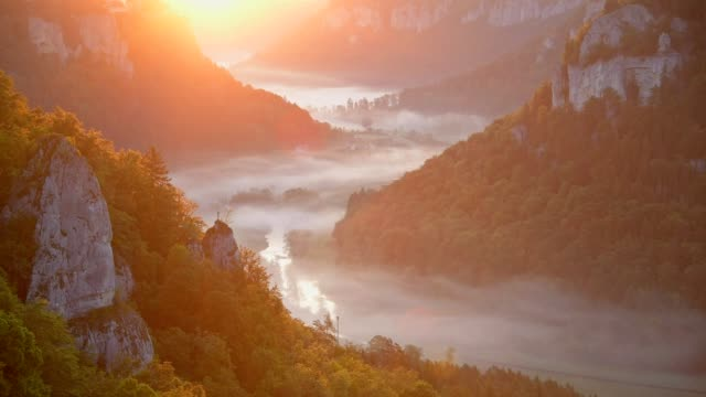 viewpoint eichfelsen at sunrise, oberes donautal, beuron, irndorf, swabian alb, swabian jura, baden-württemberg, germany - river danube video stock e b–roll