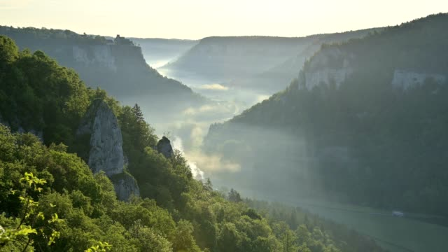 viewpoint eichfelsen in the morning, oberes donautal, beuron, irndorf, swabian alb, swabian jura, baden-württemberg, germany - river danube video stock e b–roll