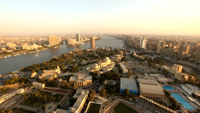 stockvideo's en b-roll-footage met ha viewpoint over nile river & city at sunset/ cairo/ egypt - caïro