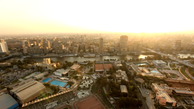 ha ws viewpoint over nile river & city at sunset with bridge/ cairo/ egypt_03 - cairo stock videos & royalty-free footage