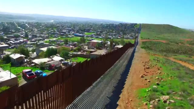 views along the us-mexico border wall in california - surrounding wall stock videos & royalty-free footage