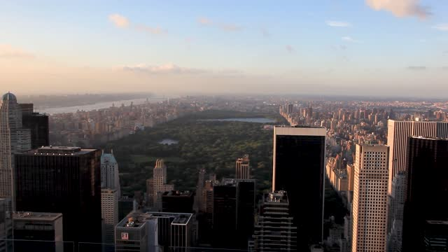stockvideo's en b-roll-footage met views and active life of manhattan in new york with people lifestyle and iconic buildings of the capital city of the world during sunset and dusk - central park manhattan