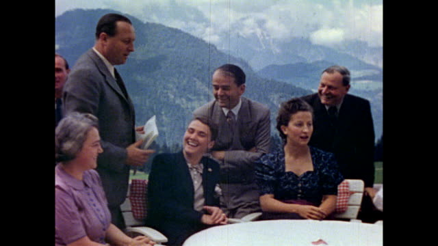 vídeos de stock e filmes b-roll de views around berghof estate / group on terrace including hitler's chief adjutant wilhelm bruckner german diplomat walter hewel max wunsche architect... - frau