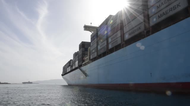 views from a boat alongside the ebba maersk container ship, operated by a.p. moeller-maersk a/s, as it leaves suez port and heads towards the red sea... - suez canal stock videos & royalty-free footage